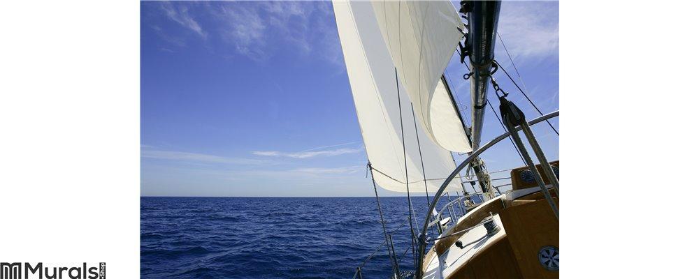 Sailboat sailing blue sea on sunny summer day Wall Mural