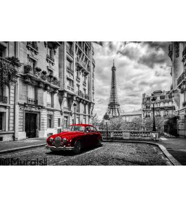 Eiffel Tower seen from the street with red retro limousine car. Wall Mural