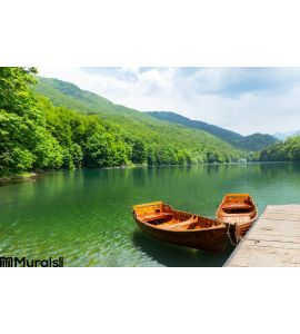 Wooden boats at pier on mountain lake Wall Mural