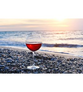 Romantic glass of wine sitting on the beach Wall Mural
