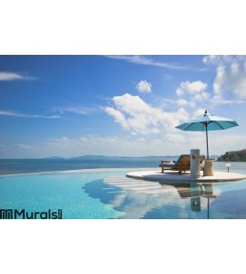 Beach chair with umbrella on private pool Wall Mural