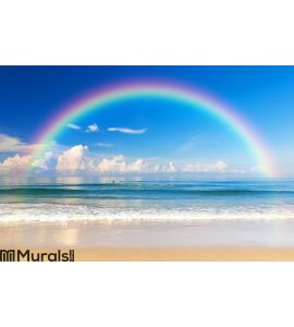 Beautiful sea with a rainbow in the sky Wall Mural