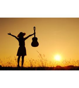 Happy woman and guitar with sunset Wall Mural